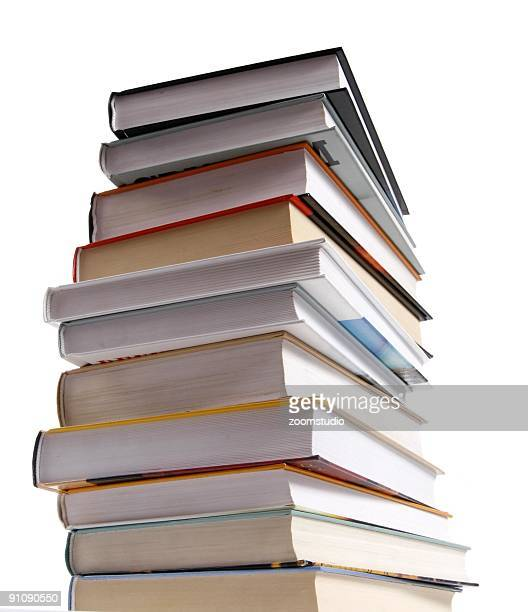 Stack of different kinds of books isolated on white