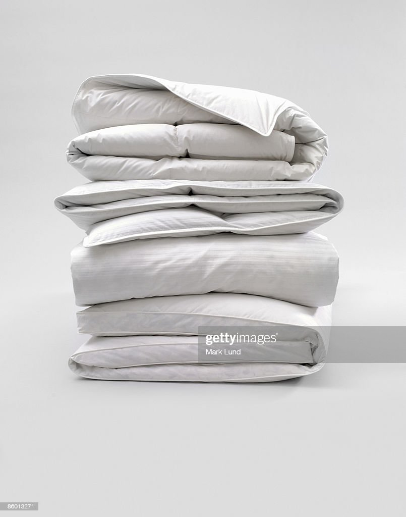 Stack of Down Comforters : Foto de stock
