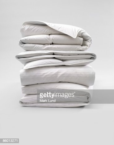 Stack of Down Comforters : Stock Photo