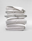 Stack of Down Comforters