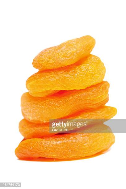 Stack of dried apricots on white