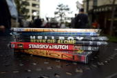 A stack of DVD's sits on a table on April 29 2004 in Los Angeles California Los Angeles City Attorney Rocky Delgadillo announced the first two...
