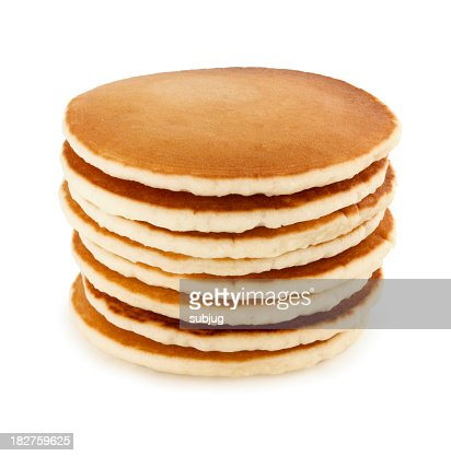 Stack of eight buttermilk pancakes on a white table