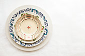 Cheerful colorful dishes decorated with floral pattern. Beautiful vintage crockery top view