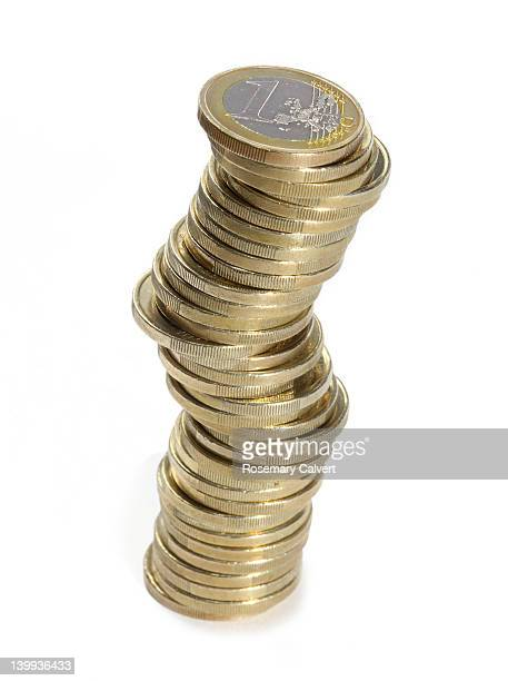 Stack of Euro coins illustrating instability.