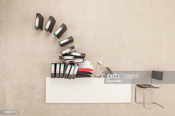 Stack of files on office desk