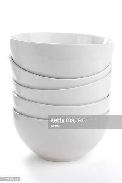 Stack of five deep white bowls isolated on white background