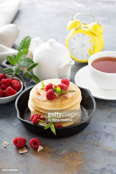 Stack of fluffy buttermilk pancakes with raspberry and coconut