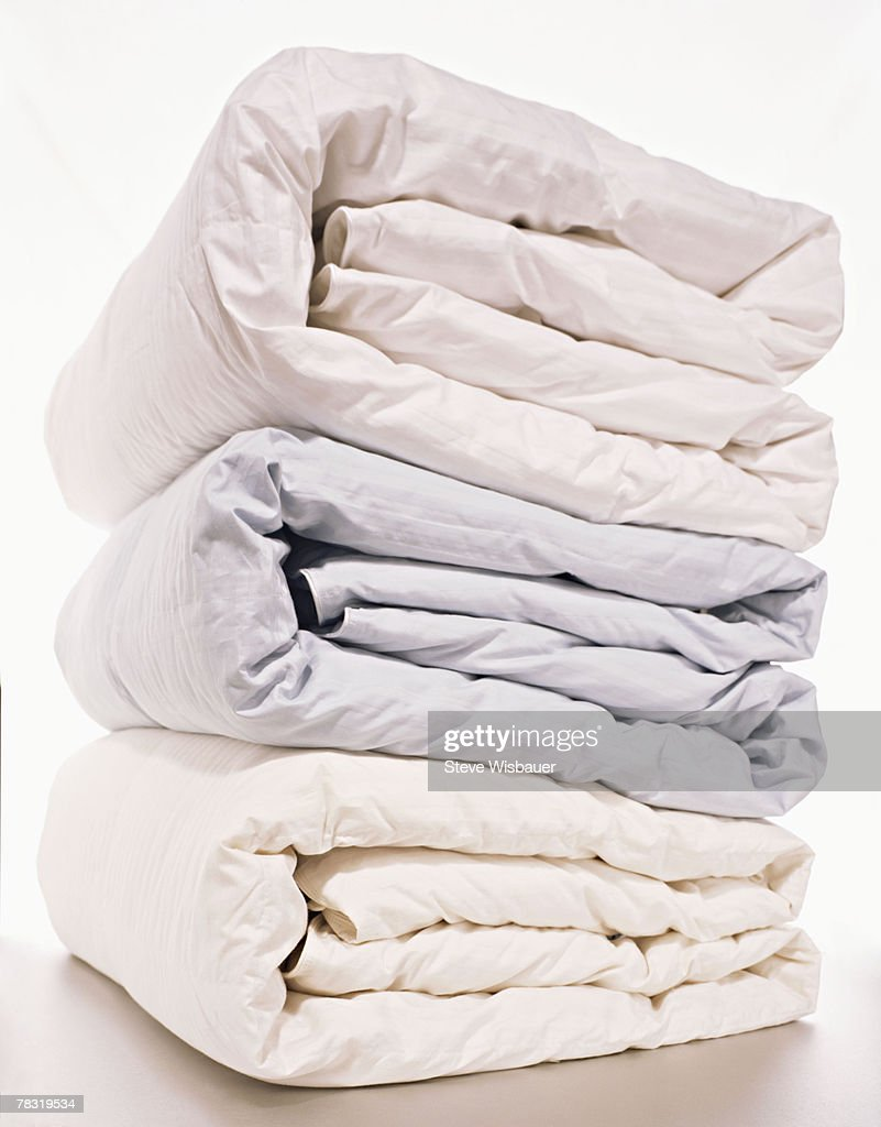 Stack of folded comforters : Stock Photo
