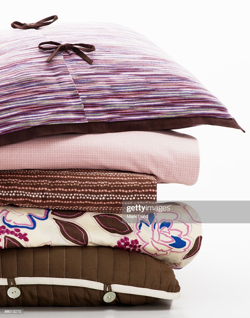 Stack of Folded Sheets and Pillows : Stock Photo