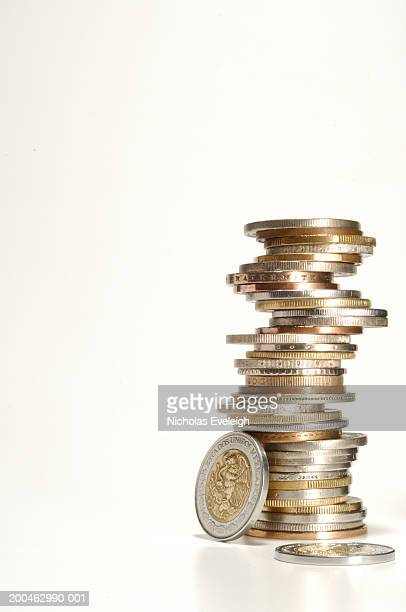 Stack of foreign coins, Mexican Peso on side