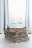 Stack of four old books