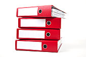 Stack of four red ring binders with spine facing viewer