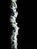 Stack of gambling chips in shadow, close-up