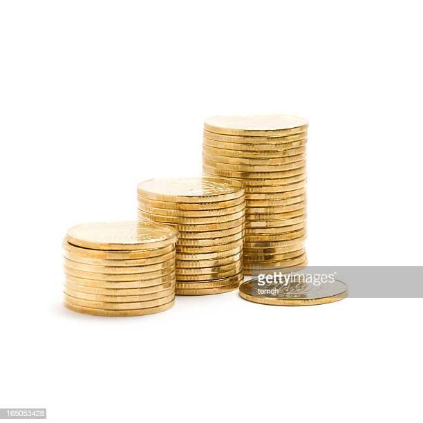 Pila de monedas de oro de color