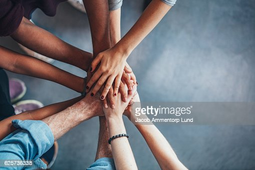 Stack of hands showing unity : Stock-Foto