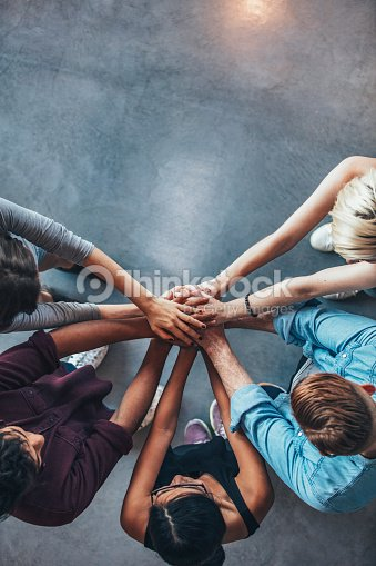 Stack of hands symbolizing trust and cooperation : Stock Photo