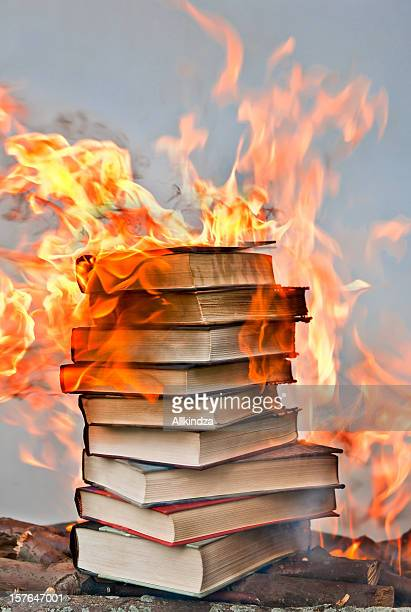 stack of hardcover burning books