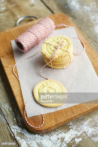 Stack of home made almond cookies on a cutting board