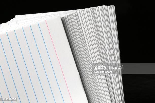 Stack of index cards on a black background
