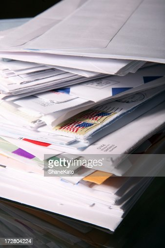 Stack of Junk Mail and Unpaid Bills