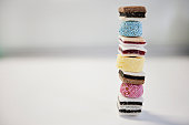 Stack of liquorice sweets on white background