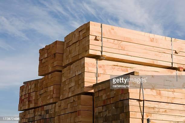 Stack of lumber in lumberyard or construction site