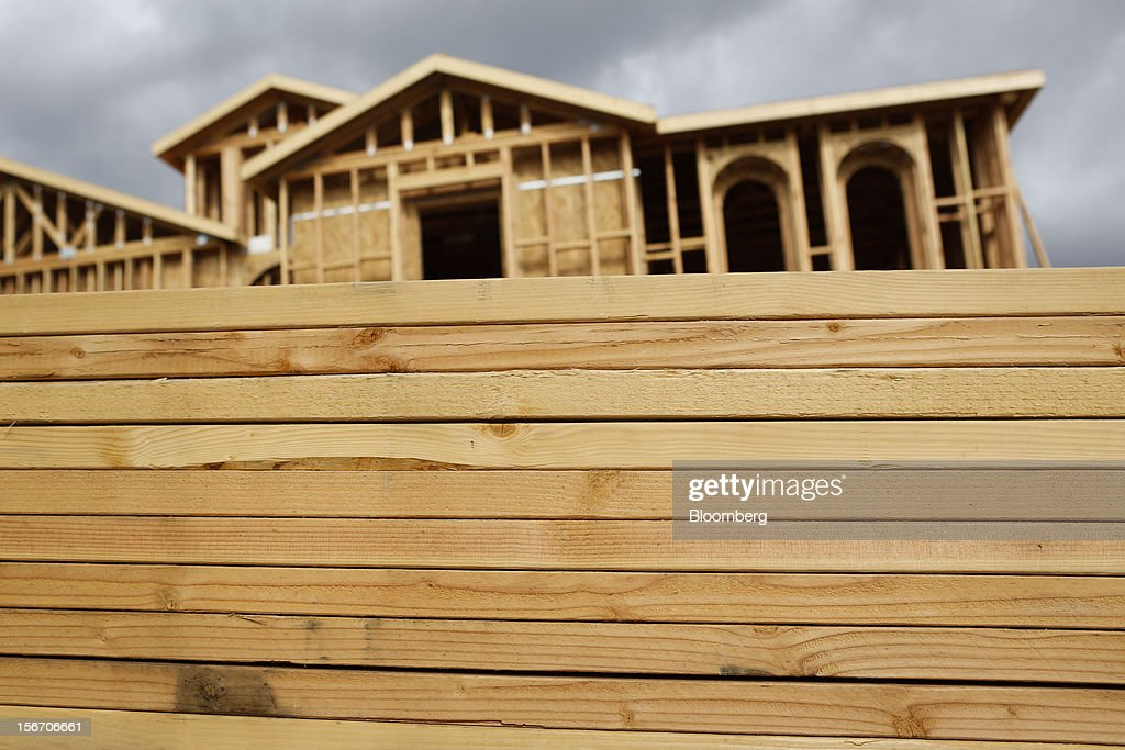 A stack of lumber sits in front of a house under construction at the Ryland Homes Vista Heights development in Rancho Cucamonga, California, U.S., on Sunday, Nov. 18, 2012. The U.S. Census Bureau is scheduled to release housing starts figures on Nov. 20. Photographer: Patrick T. Fallon/Bloomberg via Getty Images