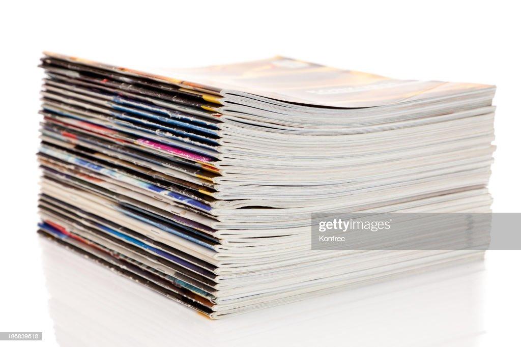 Stack of magazines isolated on white background