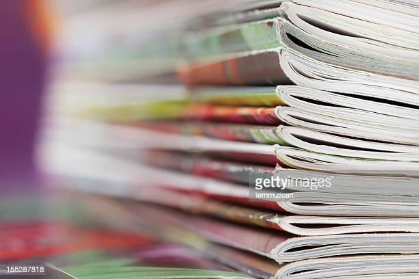 Stack of magazines that progressively blurs toward the left