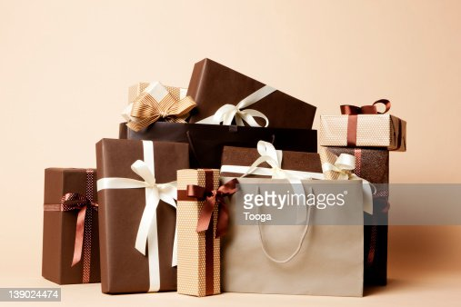 Stack of masculine gifts and shopping bags : Stock Photo