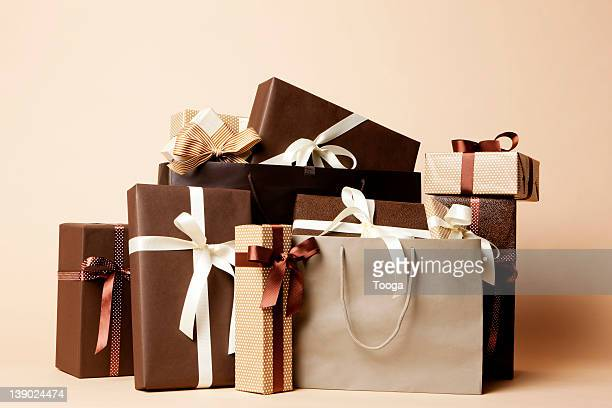 Stack of masculine gifts and shopping bags