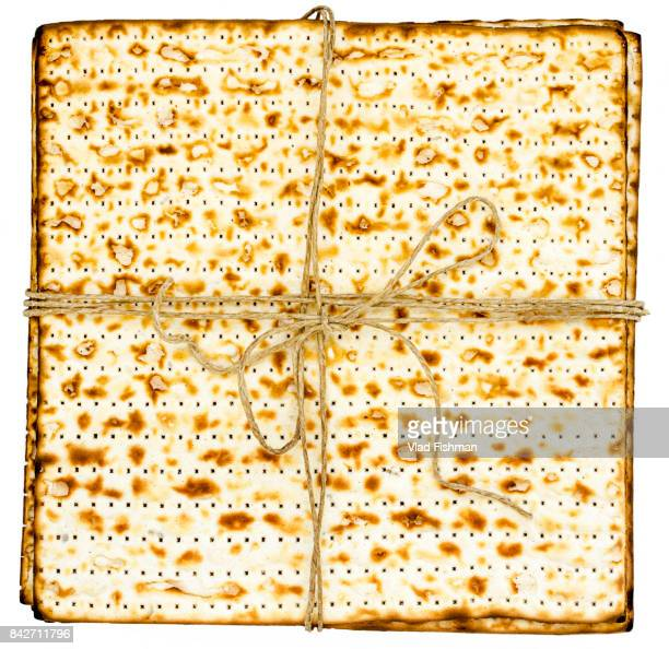 Stack of matzah or matza on white isolated background presented as a gift