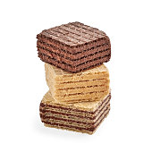 Stack of mixed square wafer biscuits isolated on white backdrop. closeup view