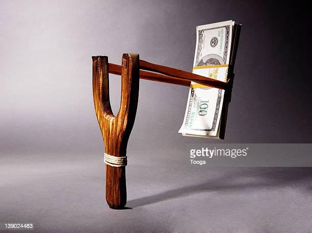 Stack of money in slingshot