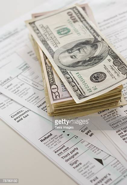 Stack of money on tax forms