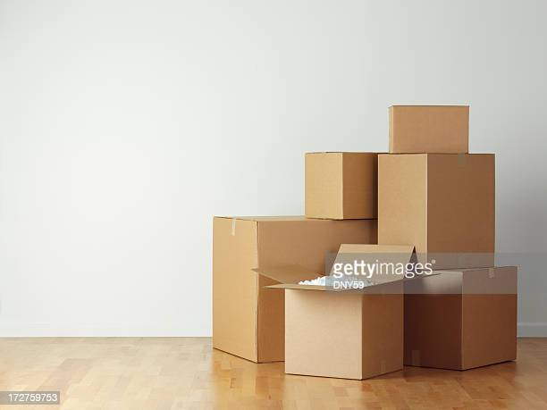 Stack of moving boxes on hardwood floor