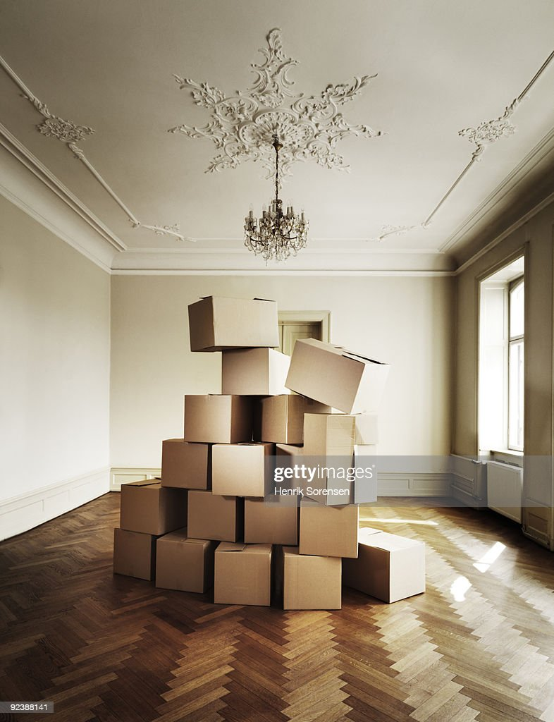 Stack of moving crates underneath chandelier