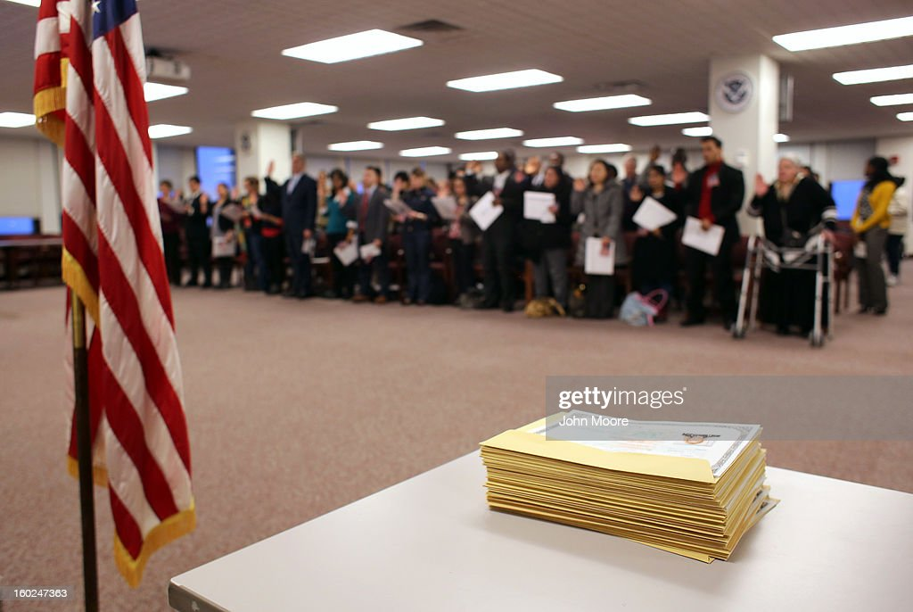 A stack of naturalization certificates awaits as immigrants take the oath of allegiance to the United States during a ceremony at the district office of U.S. Citizenship and Immigration Services (USCIS) on January 28, 2013 in Newark, New Jersey. Some 38,000 immigrants became U.S. citizens at the Newark office alone in 2012.