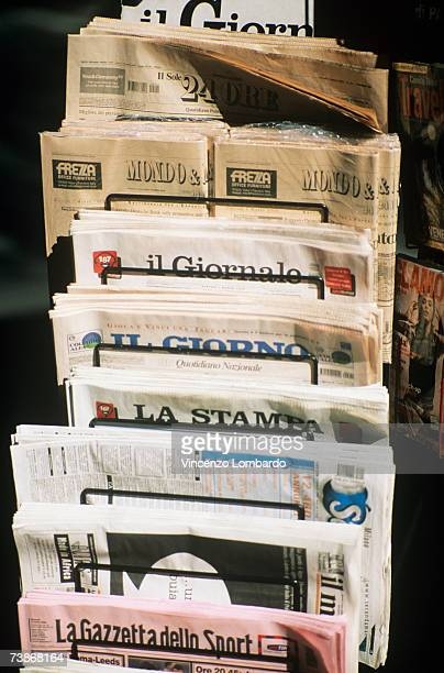 Stack of newspapers in rack outdoors, close-up