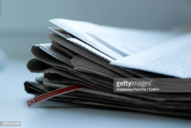 Stack Of Newspapers On Table
