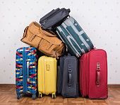 A stack of used suitcases