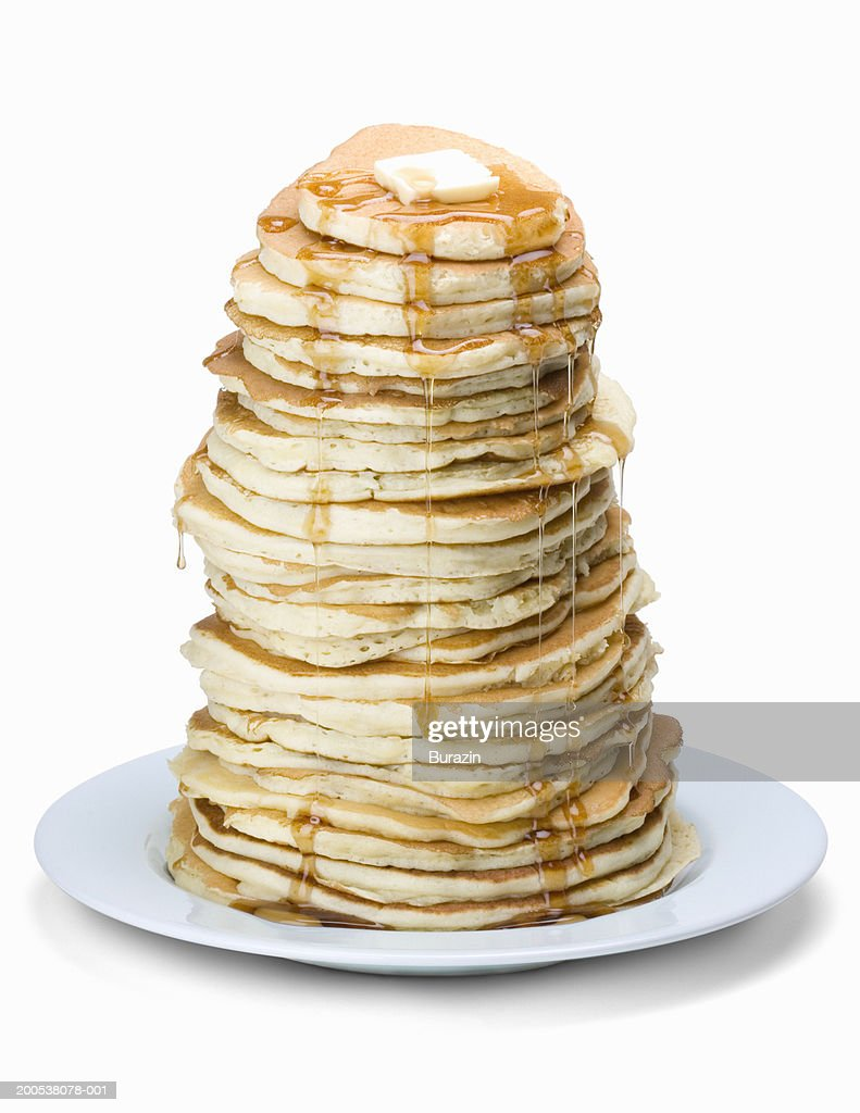 Stack of pancakes on plate, against white background, close-up : Stock Photo
