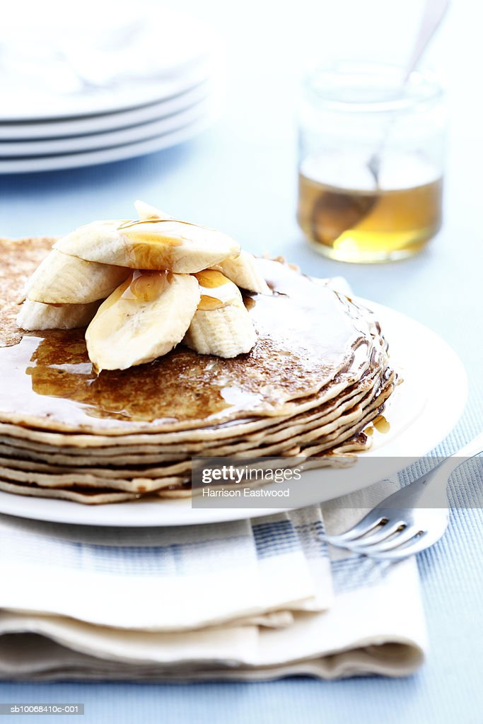 Stack of pancakes with Bananas and Honey : Stock Photo