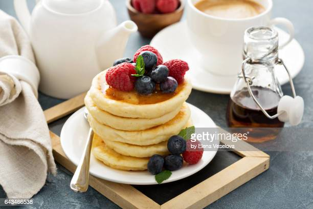 Stack of pancakes with fresh berries for breakfast