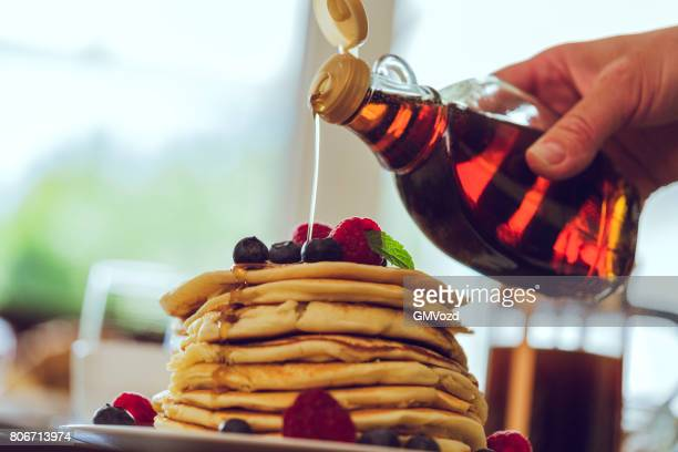 Stack of Pancakes with Maple Syrup and Fresh Berries