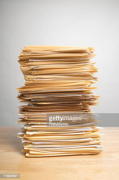 Stack of Paperwork Files on Desk Inbox