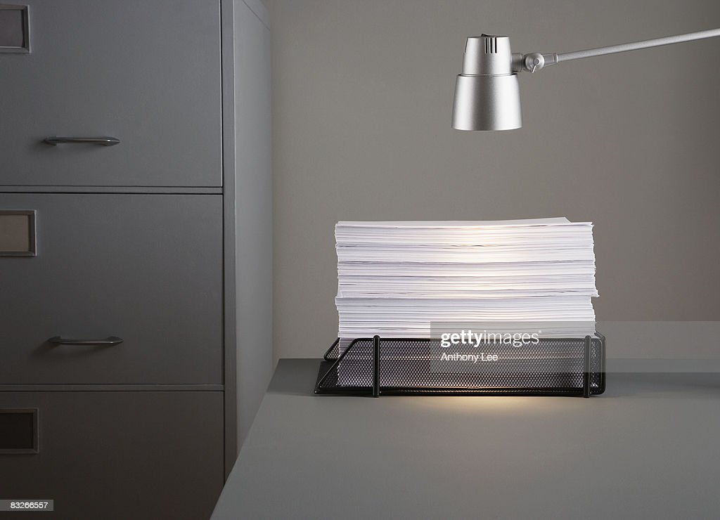 Stack of paperwork in in-tray : Stock Photo