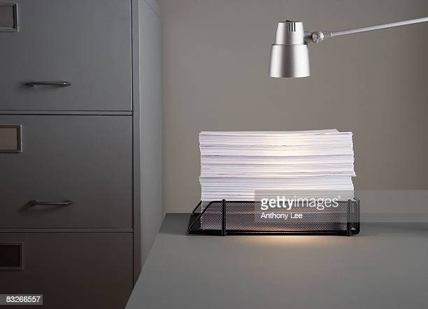Stack of paperwork in in-tray