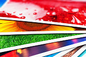 Creative abstract digital photography and photographic picture visual imaging art concept: 3D render illustration of the macro view of stack of colorful photo cards with selective focus effect